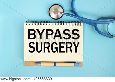 Bypass Surgery, Text On A Notebook On A Blue Background. Stethoscope In Blue.