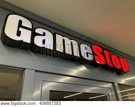 Zug, Switzerland - 6th February 2021 : Gamestop Logo Hanging Over A Store Entrance In Zug, Switzerla