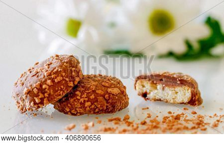 Shortbread Cookies Chocolate Glazed Sliced And Crumbs On White Table Background. Round Shortbread Co