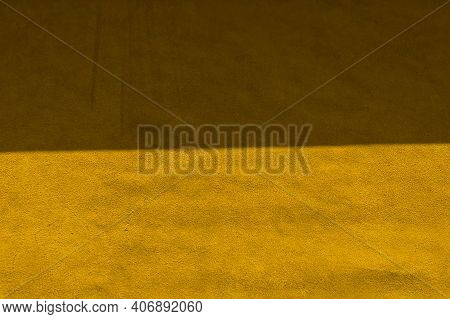 Yellow Matte Background Of Suede Fabric, Closeup. Velvet Texture Of Seamless Leather. Felt