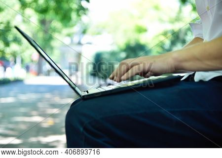 Businessman Typing On Laptop Computer. Education And Working Concept. Close Up