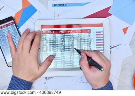 Businessman Hand Using Digital Tablet And Checking Stock Market Data. Success And Startup Concept. C