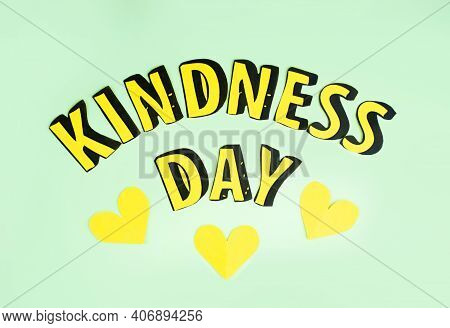 Happy Random Acts Of Kindness Day February 17. Paper Letters Text Effect On Olive Green Background A
