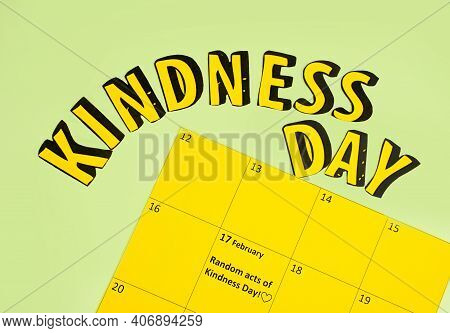 Happy Random Acts Of Kindness Day February 17. Calendar On Workplace Paper Letters Text Effect On Ol