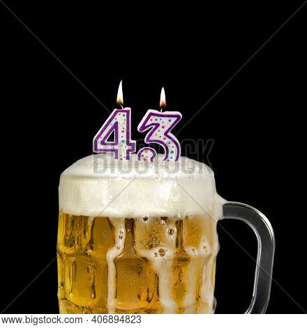 Number 43 Candle In Beer Mug For Birthday Celebration Isolated On Black