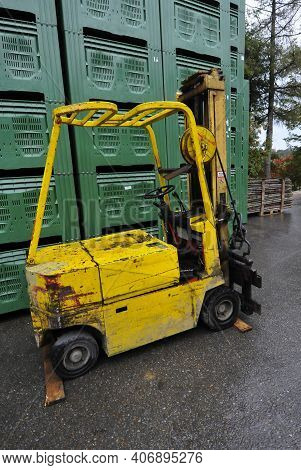 A Forklift Truck In Warehouse Logistics For Cargo And Freight Transportation