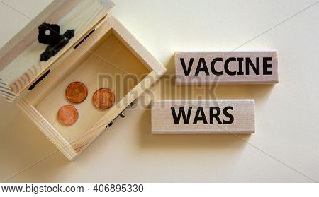 Covid-19 Vaccine Wars Symbol. Concept Words 'vaccine Wars' On Blocks On A Beautiful White Background