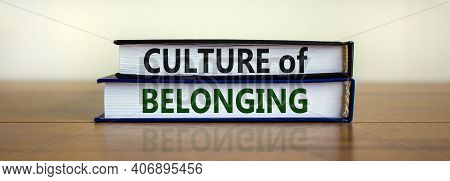 Culture Of Belonging Symbol. Books With Words 'culture Of Belonging' On Beautiful Wooden Table, Whit