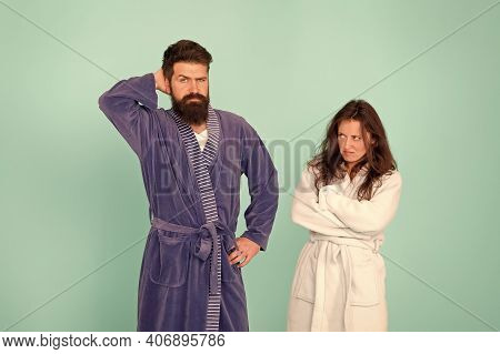 Divorce. Unhappy Couple In Love Blue Background. Sexy Woman And Bearded Man In Home Clothing. Confli