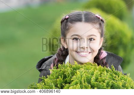 Girl Cute Smiling Kid Green Grass Background. Healthy Emotional Happy Kid Relaxing Outdoors. What Ma