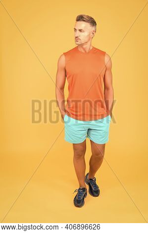 Seems Like Very Confident And Handsome. Confident Sportsman Orange Background. Confident Look Of Mus