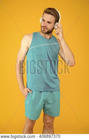 Dont Stop Training. Athletic Man Listen To Music Yellow Background. Athletic Training. Physical Trai