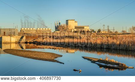 Fort Saint Vrain Generating Station near Plateville, Colorado, originally built as a nuclear power plant, currently powered by natural gas, distant view with St Vrain Creek in front