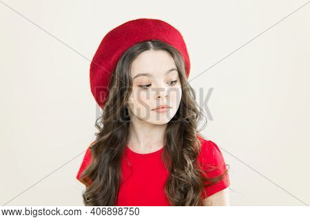 Kid Girl Long Healthy Shiny Hair. Perfect Curls. Kid Cute Face With Adorable Curly Hairstyle Wear Be
