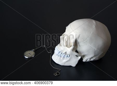 Skull On The Table Next To The Clock Of Life