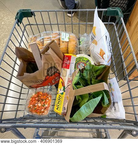 A Grocery Cart With Groceries At A Whole Foods Market