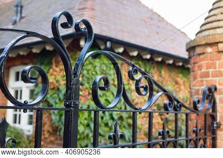 Wrought Iron Gates Closeup, Closed Black Metal Gates To A Country Manor House, Uk