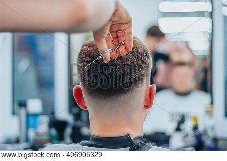 A Tattooed Woman Hairdresser Cuts Guys Hair