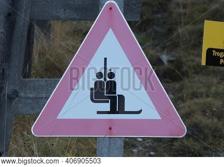 A Chairlift Warning Or Attention Sign In An Alpine Ski Area
