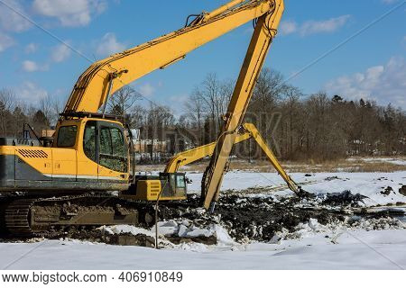Backhoe Dig Of During Earthworks The Digging Pit For At Construction Site Building