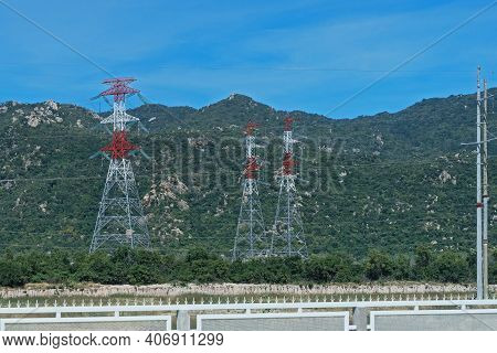 High Voltage Power Tower At The Mountain Background. Vietnam