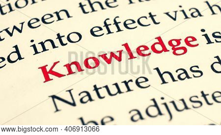 Selective Focus On The Red Word Knowledge. Macro Shot Printed Red Colour Word Knowledge On A Piece O