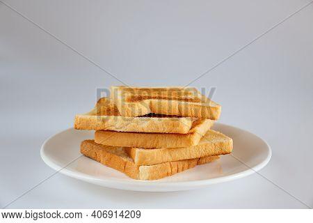 Toast Isolated On White Background. Toast On White Dish.