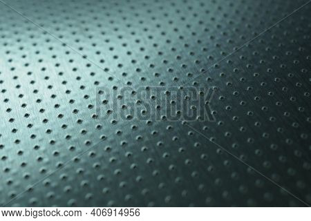 Dark Industrial Metallic Background. Tinted Blue-green Wallpaper. Perforated Aluminum Surface With M
