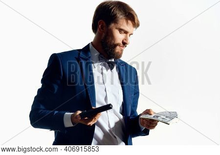 Male Gangster With A Wad Of Money And A Gun In Hand In A Classic Gangster Suit