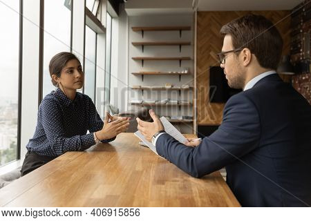 Young Man Professional Lawyer Counsel Indian Woman Customer At Office