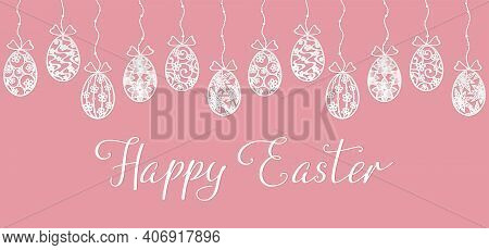 White Openwork Easter Eggs Hanging On A String With Beads And Happy Easter Hand Lettering On A Pink