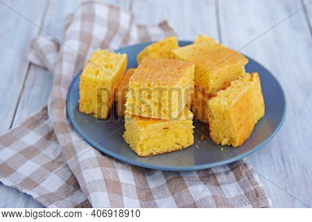 Sliced Cornbread On A Gray Plate On A Light Wooden Background. Corn Flour Recipes. American Food. Co