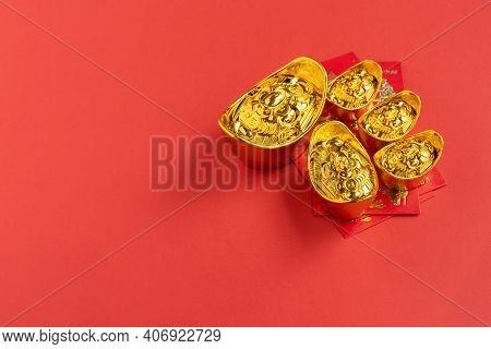 Red Envelope And Golden Ingot On Red Background