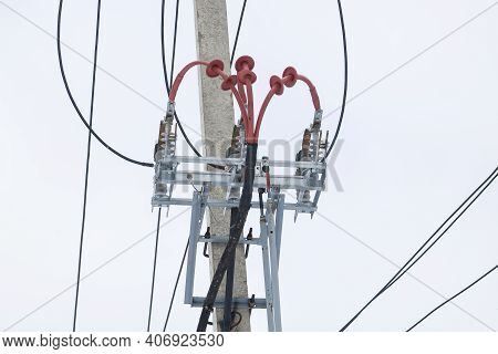 Supports of power lines. Power lines and posts. Detailed close-up.