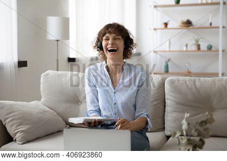 Smiling Woman In Headphones Laugh Talking On Laptop
