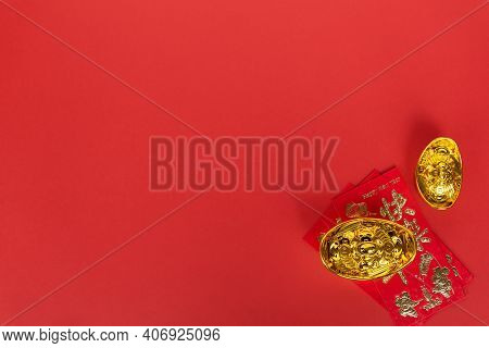 Directly Above View Of Red Envelope And Golden Ingot With Copy Space