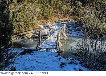 Wooden Bridge In Mengusovska Valley, High Tatra Mountains, Slovak Republic. Hiking Theme.
