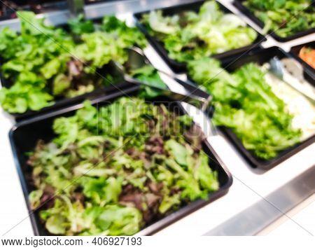 Blurred Green Salad Bar. Healthy Eating Concept