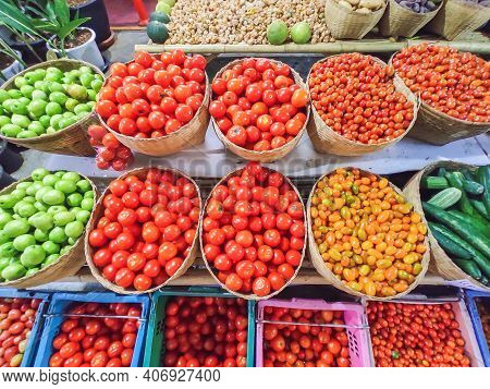 Varieties Of Fresh Organic Tomatoes In Basket At The Market. Healthy Eating Concept