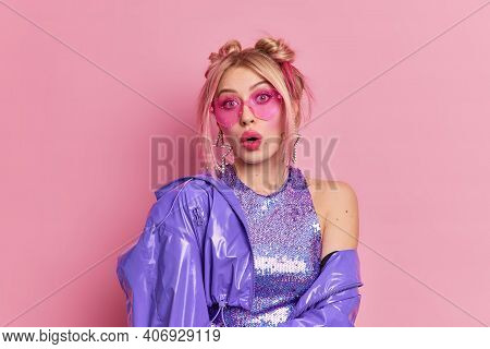 Surprised Fashionable Caucasian Woman With Two Hair Buns Has Stunned Expression Wears Trendy Pink Su