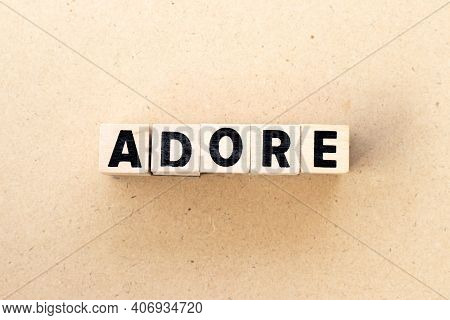 Letter Block In Word Adore On Wood Background