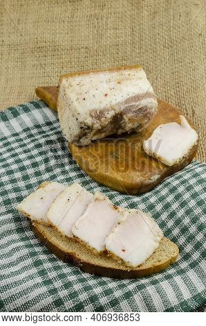 Traditional Ukrainian Food. Sliced Salted Fat And Rye Bread On Green Checkered Cloth. A Piece Of Sal