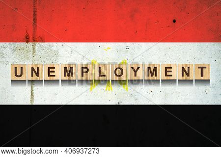 Unemployment. The Inscription On Wooden Blocks On The Background Of The Egypt Flag. Unemployment Gro