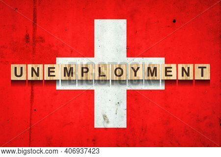 Unemployment. The Inscription On Wooden Blocks On The Background Of The Switzerland Flag. Unemployme