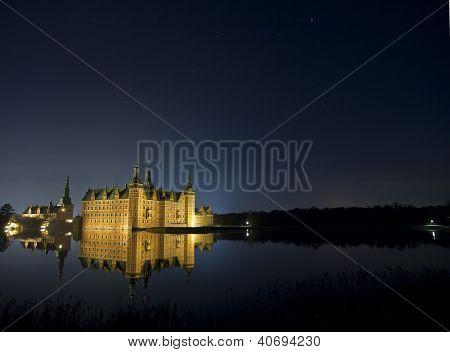 Frederiksborg Castle in winter night