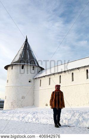 Woman On Background Of Southwest Tower Of Kazan Kremlin In Winter, Russia
