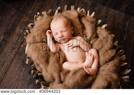 2. Newborn Baby Boy Is Napping In A Wooden Basket At A Newborn Photoshoot