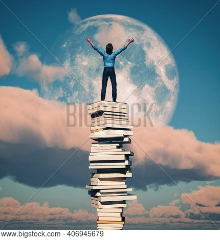 Man With Raised Hands On A Stack Of Books. Scholarship And Education Concept . This Is A 3d Render I