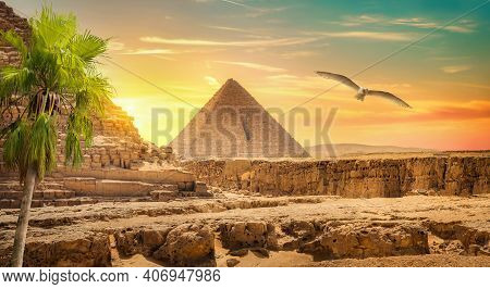 Egyptian Pyramid In Sand Desert And Clear Sky