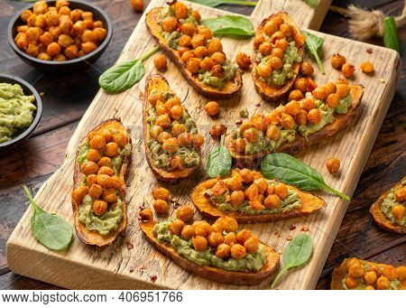 Sweet Potato Toast Loaded With Avocado Guacamole And Baked Chickpeas Sprinkled With Chili Flakes Ser